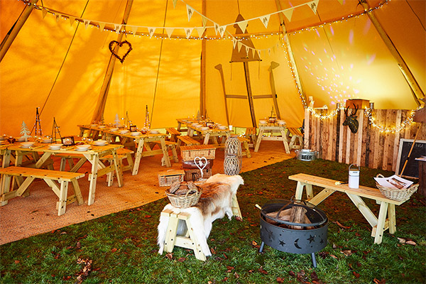 howell manor open day new year tipi inside rustic benches