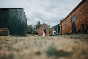 rustic farmyard with couple in the background