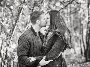 carissa and lewis engagement photograph in the woods black and white