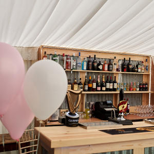 howell manor fully stocked bar with balloons in the foreground